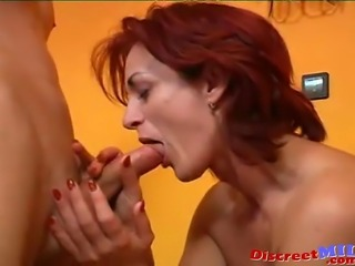 Redhead sexy mature MILF gets fucked on the couch by young guy while her...