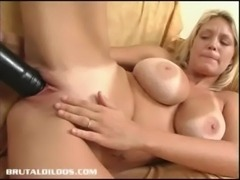 Busty babe with a big black dildo free