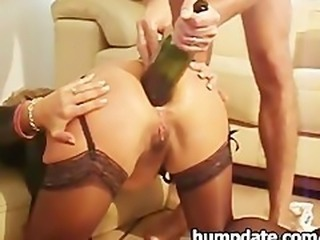 Wife gets a bottle and fist in her ass