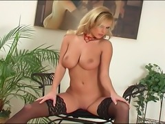 Busty blonde in stockings and sheer lingerie stripping out of her panties