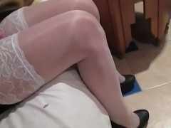 Checking her white stockings in hotel room