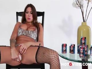 Busty big tit Latina pornstar, Kayla Carrera, masturbates with her sex toys.