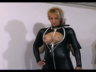 Busty slave girl in latex gets her boobs and hands tied up by her mighty master