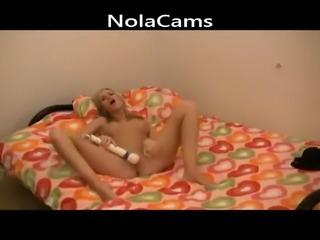 Teen camslut uses a powerful vibrator on her tiny twat