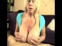 Huge titted granny gives a titfuck free