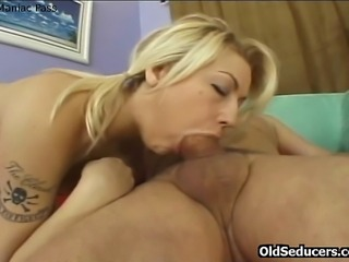 Twenty years old blondie taking old playboy's cock into her wet young pussy
