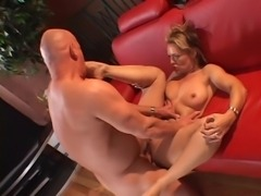 Sexy blonde MILF in white leggings gets fucked on couch