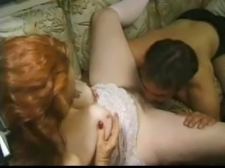 Mature redhead gives blowjob, gets fucked and receives facial