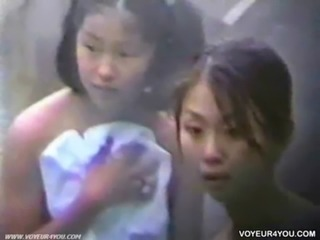 Young girls enjoying bathing free