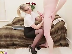 Beautiful CFNM office babe gives naked guy a blowjob