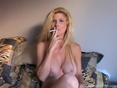 Beautiful blonde MILF enjoys a smoke break free