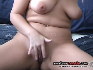 Chubby wife takes off her fitness jammies and talks to the cameraman while sitting back on the bed to striptease.  She removes everything and masturbates for you!