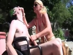 Hot mom gives femdom handjob to disabled guy