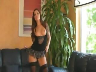 Brunette babe finger on leather sofa