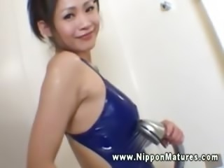 Hot asian in swimsuit showers and slowly undresses