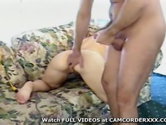 MILF sits outside in her bra and panties and then goes inside where she is...