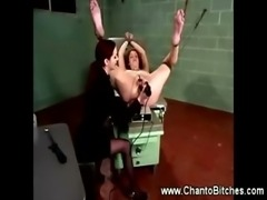 Dominatrix uses a speculum on her bounded slave