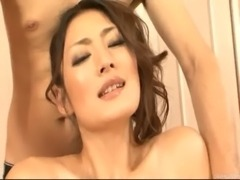 Risa loves having her furry muff slicked down with oil and fingered by two guys free