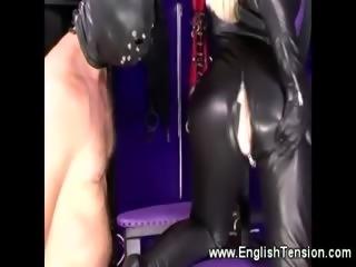 Horny domina in a bodysuit demands pleasuring