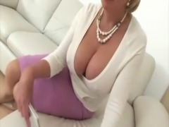 Mature blonde in glasses shows big tits free