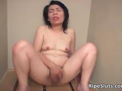 Mature Asian bitch masturbates