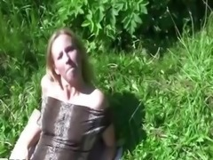 Hot sun bathing babe showing off tits  for lucky guy
