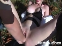 Hot blond babe fist fucked in a public park free