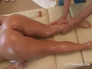 Blonde temptress gets ass and cunt oil massaged
