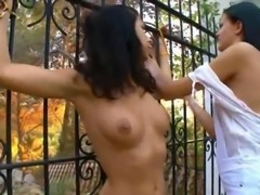 Charming lezzies teasing in a garden