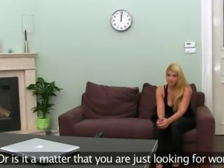 Big tits blondie posing herself on sofa