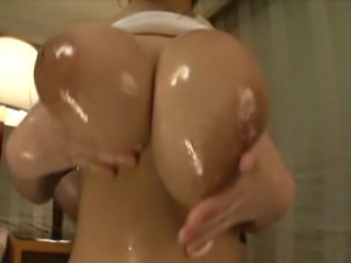 Softcore clip of Ria getting her tits oiled, bounced and played with.
