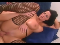 Busty brunette fucked in black thigh high stockings and a garter belt