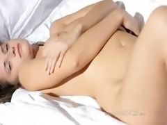 Busty girl wow stripping on a bed