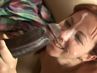 Cute redhead takes massive facial from huge BBC.