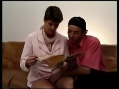 FRENCH MATURE n37 brunette hairy mom on a sofa