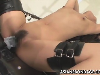 If you are a fan of bondage and fucking machine, this video is for you: After being bond and in suspension rope, this poor Japanese babe gets deeply fucked by a fucking machine, a hot Asian bandage porn video!