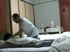 Naughty Japanese wife patiently waits for her massage.