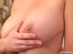 Adrianne Black dominates Busty Ellen by playing with the big boobs, sucking...