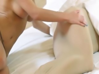 Horny young chicks with strapon on bed