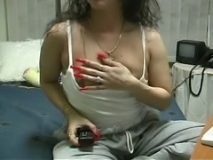 Sexy chick plays with her tits using her sexy long nails