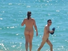 Beauty walks fully nude on beach
