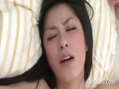 Asian brunette taking a messy facial after hardcore sex