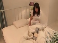 Delicate asian schoolgirl seducing a guy in her bed