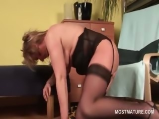 Sexy mature in stockings finger fucking her wet pussy