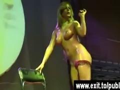 Public Lia pouring coconut milk over her body