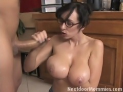 Big breasted mom strokes a black cock free