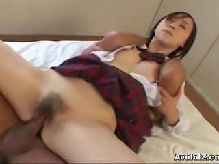 Cute Japanese coed rides her first cock here. She likes to feel a big hard cock inside in her tight hairy pussy!