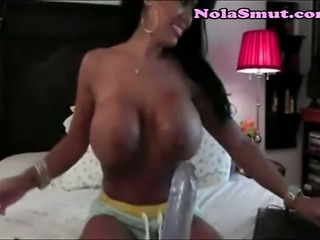 Beautiful tanned MILF masturbates for younger