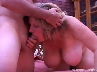 Gorgeous older babe with lovely large boobs fucks a lucky younger guy who cannot wait to jizz on her huge jugs
