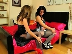 Two brunette lezzies posing in nylons